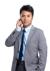 Asian businessman talk to mobile phone