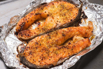 Baked trout steak cooked in the oven