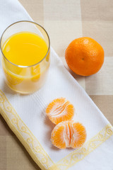 Manderin orange segments with a glass of orange juice