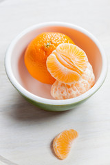 Manderin orange segments in a green bowl