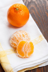 Manderin orange segments with a whole manderin in the background