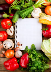Fresh Vegetables on a Wooden Background and Paper for Notes