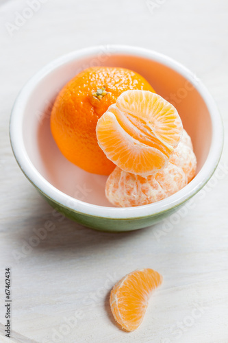 Manderin orange segments in a green bowl