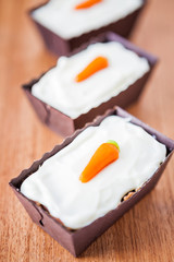 Three mini carrot cakes with mascarpone icing