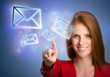Woman pressing virtual email icons