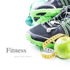 Sport shoes and green apple
