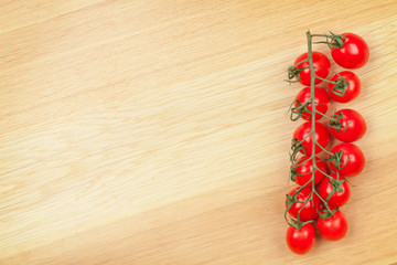 Cherry tomatoes on wooden table background