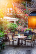 Cafe terrace in small European city - 67463427