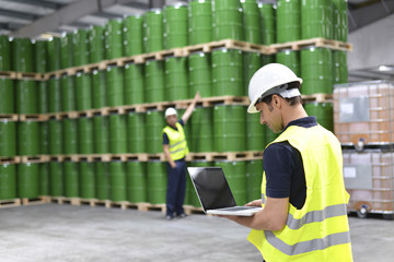Workers with a notebook in logistics company