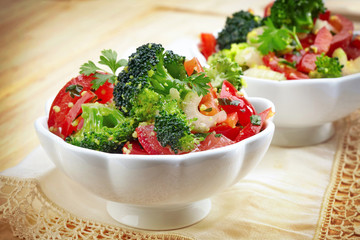 two bowls of vegetable salad