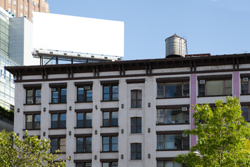 Big, white, blank, billboard on the red brick building.
