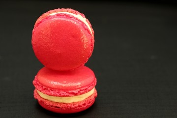 Pink Macaron Close up against black background