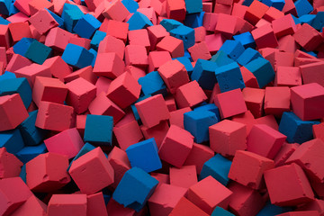 Red and blue sponge cubes.