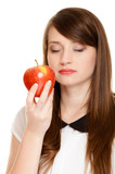 Diet. Girl smelling apple seasonal fruit.