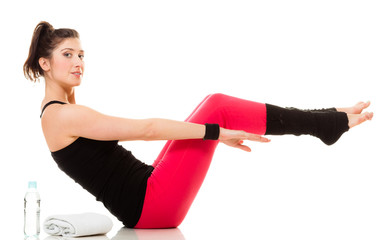 Flexible girl doing stretching pilates exercise