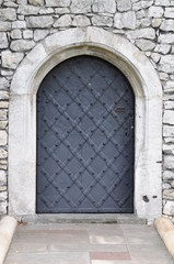 Old iron door and stone wall
