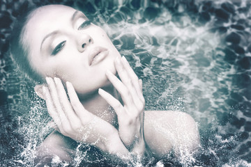 beauty female portrait with water drops and foam