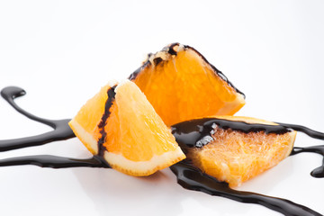 orange slices with melted chocolate threads