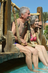 Old couple in pool