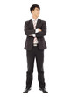 smiling businessman standing and crossed arms over white