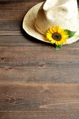 Straw hat with sun flower