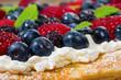 Fresh berry tart with cream
