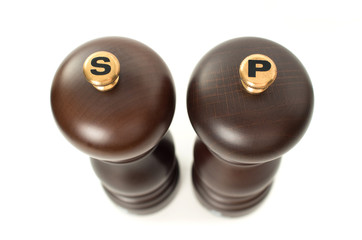 Top view of Wooden salt and pepper shakers on white background