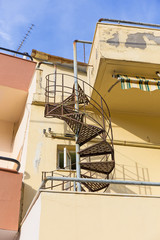 spiral staircase connecting the two floors of the house