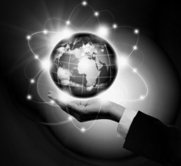 Man holding a glowing earth globe in his hands.Black and White