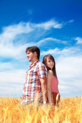 Man and woman on a wheat field