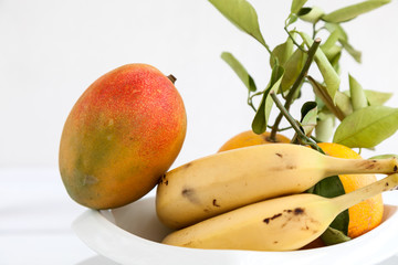 Bananas mango and fresh oranges