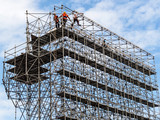 Fototapety Bauarbeiter auf einem Gerüst
