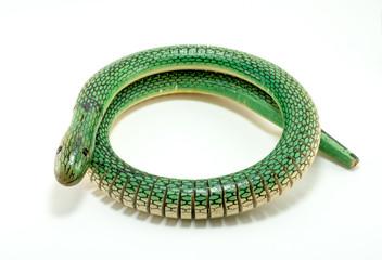 green wooden snake