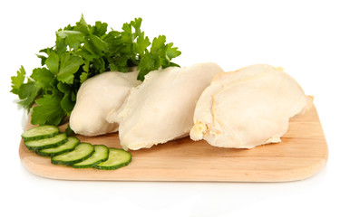 Boiled chicken breast on wooden cutting board isolated on white
