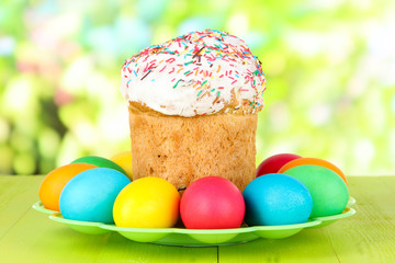 Sweet Easter cakes with colorful eggs