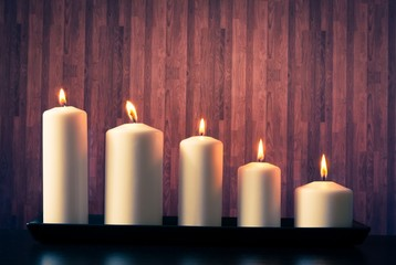 white candles on warm atmosphere
