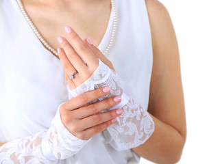 Wedding gloves on hands of bride, close-up, isolated on white