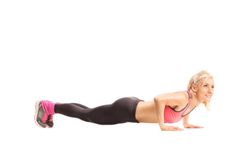 Profile shot of a woman doing push-ups