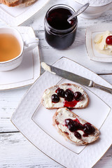 Fresh bread with cherry jam and homemade butter