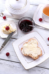 Fresh toast with  homemade butter on plate on wooden background