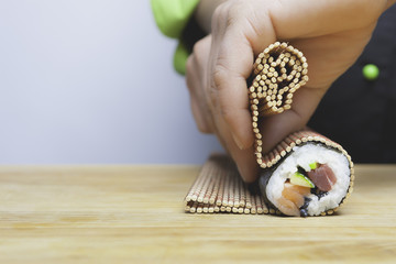 rolling up sushi