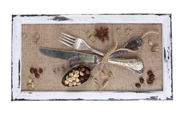 Wooden frame and vintage cutlery and spices  isolated on white