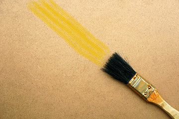 Brush painting on wooden background