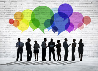 Group of Business People Discussing With Colorful Speech Bubbles