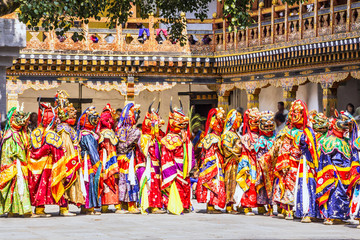 masked dancers in a row