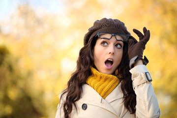 Funny fashion surprised woman with eyewear in autumn