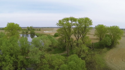 Beautiful panorama of river and trees in fields.  Aerial
