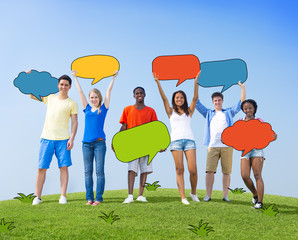 Group of People Holding Colorful Speech Bubbles