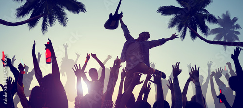 Silhouettes of People Enjoying a Concert on the Beach - 67479865