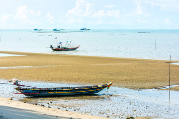 Beach with fishing boats on the sea